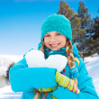Lovely girl with heart made of snow — Stock Photo