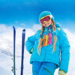 Happy girl with her mountain skis — Stock Photo