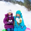 Two girls with snow hearts — Stock Photo