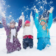 Three happy girls having fun with snow — Stock Photo