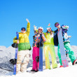 Stock Photo: Four happy friends with snowboards