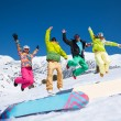 Jumping snowboarders — Stockfoto