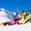 Three students in snow with snowboards — Stock Photo