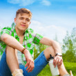 Young man resting on the grass — Stock Photo