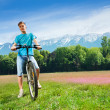 Man on the bike on the field — Stock Photo