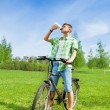 Biker man fulfilling thirst — Stock Photo