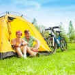 Yong couple with bikes in a tent — Stock Photo