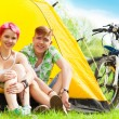 Couple sitting in a tent — Stock Photo