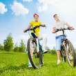 Couple on the bikes — Stock Photo