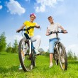 Man and woman on bikes — Stock Photo