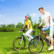 Two people on bikes — Stock Photo
