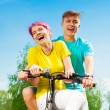 Laughing couple on the bike — Stock Photo #28479065
