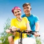 Happy couple on the bike — Stock Photo #28479067