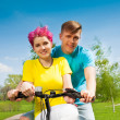 Lovely couple on the bike — Stock Photo #28479075