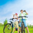 Young bikers with water bottles — Stock Photo