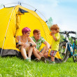 Young family in a tent — Stock Photo