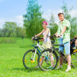 Couple with kids on the bikes — Stock Photo