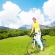 Young woman on a bike — Stock Photo