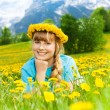 Stock Photo: Beautiful little girl in dandelions