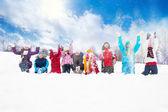Group of kids throwing snow in the air — Stock Photo
