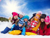 Group of happy kids outside at winter — Stock Photo
