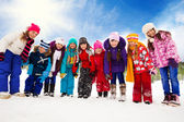 Many kids together on snow day — Stock Photo