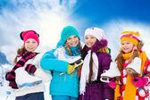 Four girls going ice skating — Stock Photo