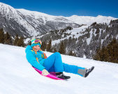 Sliding on sled from the mountain slope — Stock Photo