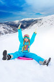 Sliding on sled from the slope — Stock Photo