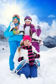 Kids with ice skates — Stock Photo