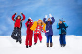 Kids jumping in snow — Stock Photo