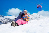 Girl with snowboard on ski resort — Stock Photo