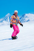 Snowboarder sliding downhill — Stock Photo