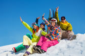 Happy friends on snowboard resort — Stock Photo