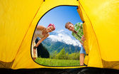 Couple looking into tent — Stock Photo