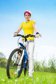 Smiling woman on bicycle — Stock Photo