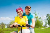 Lovely couple on the bike — Stock Photo