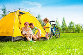 Yong couple with kid in a tent — Stock Photo