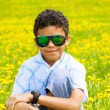 Black boy in dandelions — Stock Photo