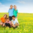 Five happy kids in dandelions — Stock Photo