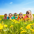 Kids in flowers — Stock Photo