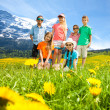 Kids in the mountains flower field — Stock Photo