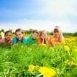Kids in a row in flower field — Stock Photo