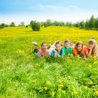 Kids in flower field — Stock Photo