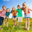 Kids hugging standing in the field — Stock Photo