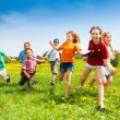 Group of happy running kids — Stock Photo