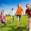 Group of running kids — Stock Photo