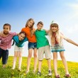 Five happy kids in the park — Stock Photo