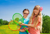 Girls with tennis racquets — Stock Photo