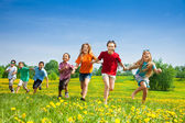 Kids running in the field — Stock Photo